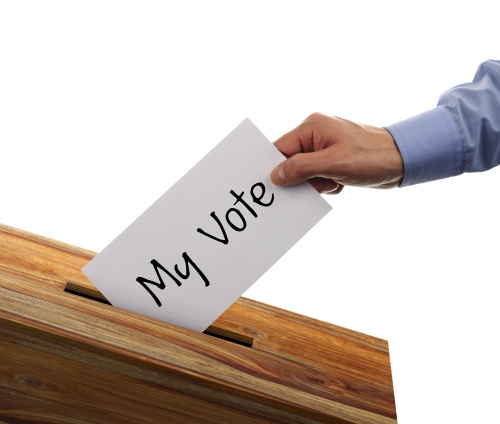 Ballot box with person casting my vote on a voting slip